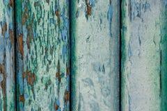 老木板绘与蓝色和绿色油漆几层数  免版税库存照片