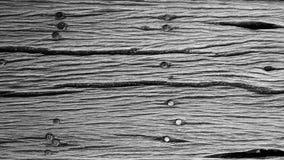 老木纹理背景纹理与钉子的 库存图片