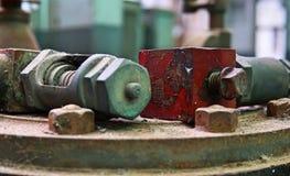 老机器齿轮的图象有数的拧紧大小 残破和ru 库存图片