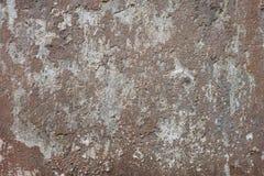 老棕色和灰色被风化的墙壁背景 库存照片