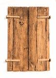 老棕色木快门从破裂的一点形成了 免版税图库摄影