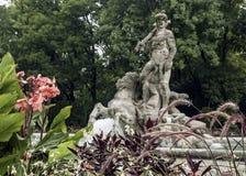 老植物园,海王星喷泉在慕尼黑,德国 图库摄影