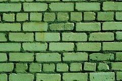 老概略的绿色砖墙样式 库存照片