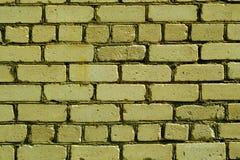 老概略的黄色颜色砖墙样式 免版税库存照片