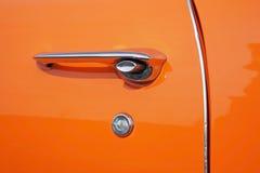 老橙色汽车详细资料  免版税库存照片