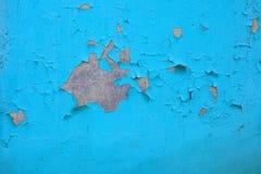 老油漆和水泥墙壁,破裂的墙壁颜色蓝色 免版税图库摄影
