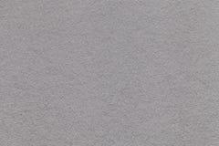 老浅灰色的纸特写镜头纹理  密集的纸板的结构 银色背景 库存图片