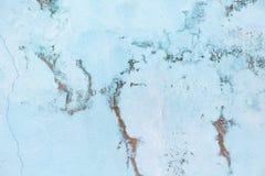 老淡色蓝色墙壁以擦伤处 与大理石作用,拷贝空间,最小的样式背景的背景 免版税图库摄影