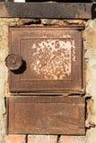 老火炉的金属门 库存照片
