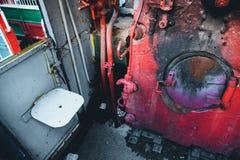 老火车小室蒸汽废物 免版税图库摄影