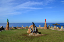 老灯塔在塔皮亚海口,阿斯图里亚斯,西班牙 库存照片
