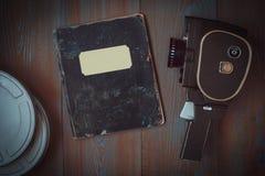 老照相机、箱影片和笔记本 库存图片