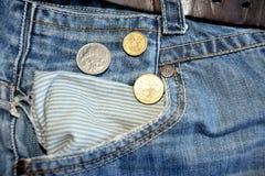 老牛仔裤和澳大利亚元硬币 库存照片