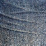 老牛仔裤背景 库存照片