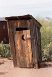 老狂放的西部外屋卫生间 免版税库存照片