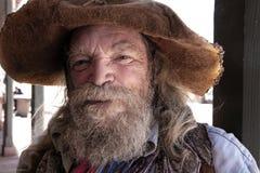老狂放的西部牛仔矿工字符 库存照片