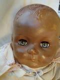 老玩偶面孔 库存图片