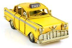 老玩具黄色出租汽车 免版税库存图片