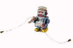 老生锈在背景的机器人玩具 免版税图库摄影