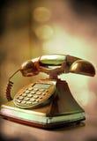 老电话有减速火箭的背景 免版税库存图片