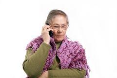 老电话联系的妇女 免版税库存图片