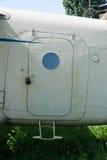 老白色被绘的飞机门关闭  免版税库存照片