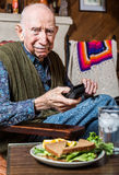 更老的绅士用三明治 图库摄影