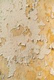 老真正的墙壁难看的东西纹理油漆,黄色口气 图库摄影