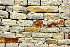 老石制品墙壁 免版税图库摄影