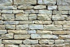 老石制品墙壁 免版税库存图片