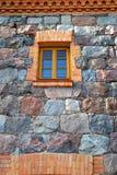 老石墙和视窗 库存照片