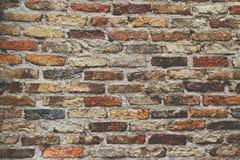 老石墙背景葡萄酒 库存照片