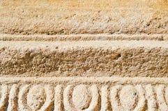 老石头黄沙石头的纹理与样式和条纹的 抽象背景异教徒青绿 免版税图库摄影