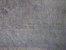 老石背景纹理 被抓的洞墙壁生锈的样式 免版税库存图片
