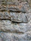 老石背景纹理 被抓的洞墙壁生锈的样式 图库摄影