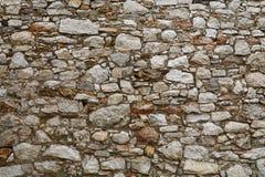 老石头分层了堆积堡垒或城堡墙壁  库存照片
