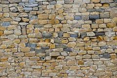 老石头层状墙壁 免版税库存照片