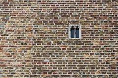 老砖砌和窗口在布鲁基,富兰德,比利时 库存图片