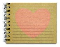 老笔记薄桃红色心脏 免版税库存照片
