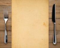 老纸、叉子和刀子 库存照片