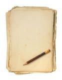 老纸张和铅笔。 免版税库存照片