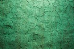 老纹理绿色崩裂了墙壁,老油漆纹理 免版税库存图片