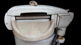 老绞扭机洗衣机 库存照片