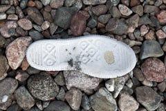 老网球鞋 免版税图库摄影