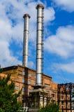 老能源厂的烟囱在城市Kremenchug,乌克兰 免版税库存图片