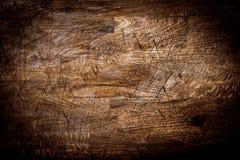 老脏的被计分的木头背景纹理  免版税库存图片