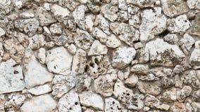 老自然凝灰岩石墙  库存图片