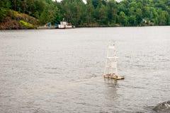 老航海标记在水中 库存照片