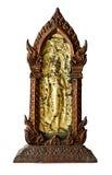 老菩萨雕象用金黄板材盖 库存图片