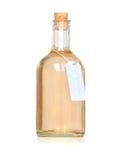老葡萄酒瓶充满自创柠檬水 库存图片